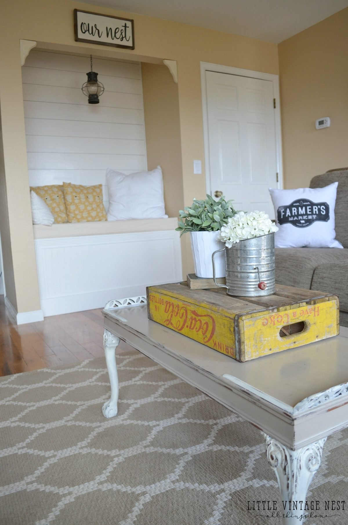 10 Ways to Get Farmhouse Style in your Home. Coke Crate on coffee table.
