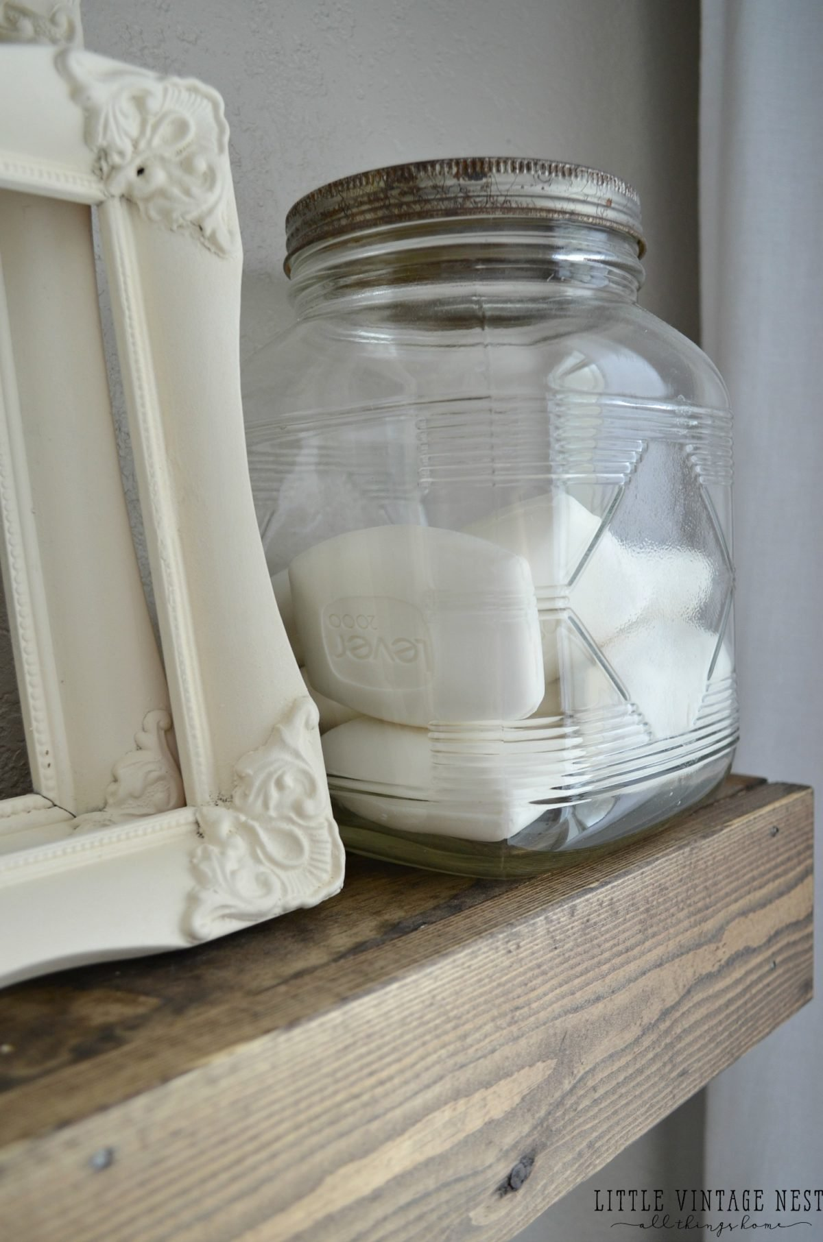 How to Decorate with Vintage Decor::Glass Jar used for soap