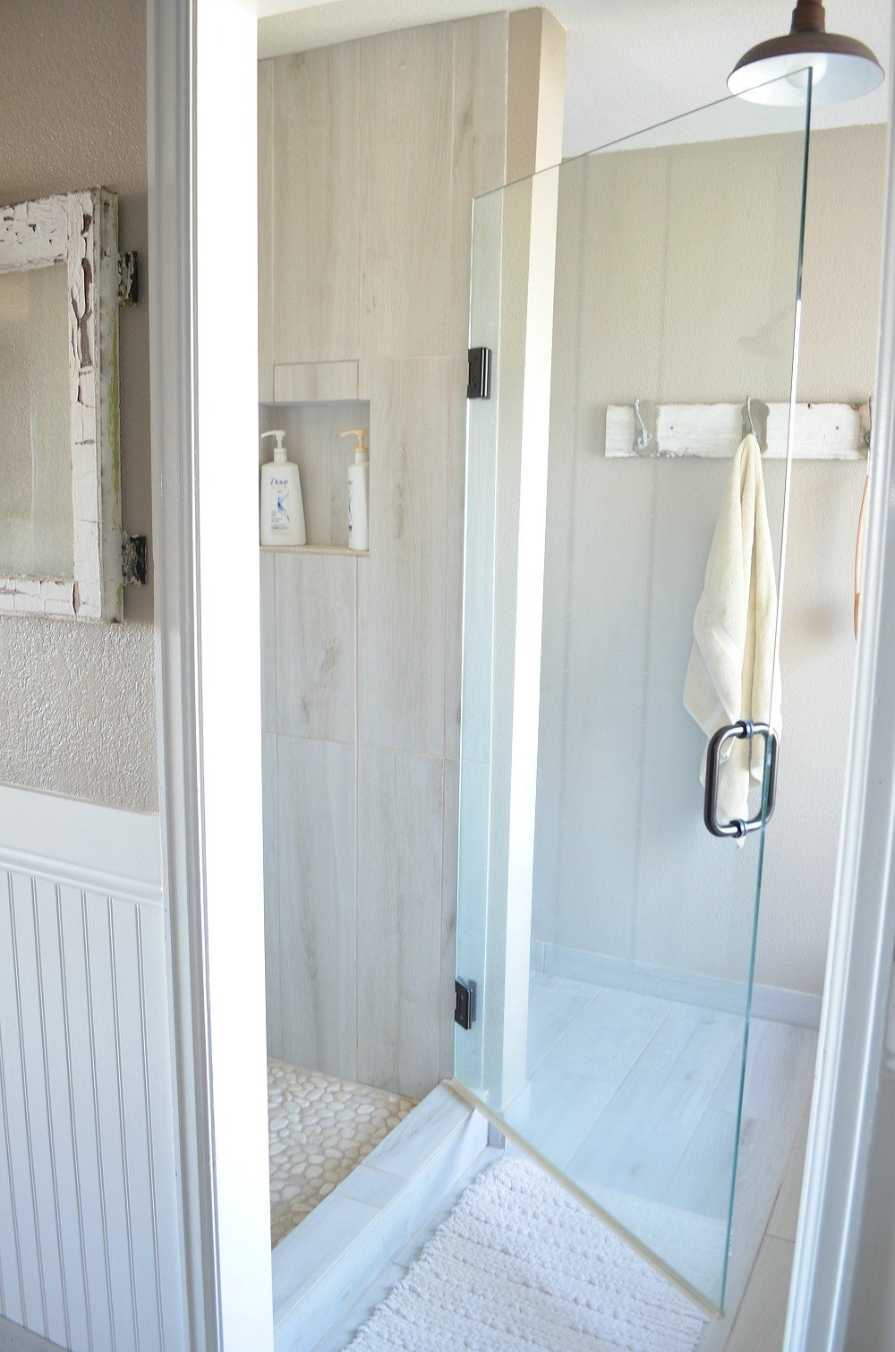 Modern farmhouse bathroom with euroglass shower door.