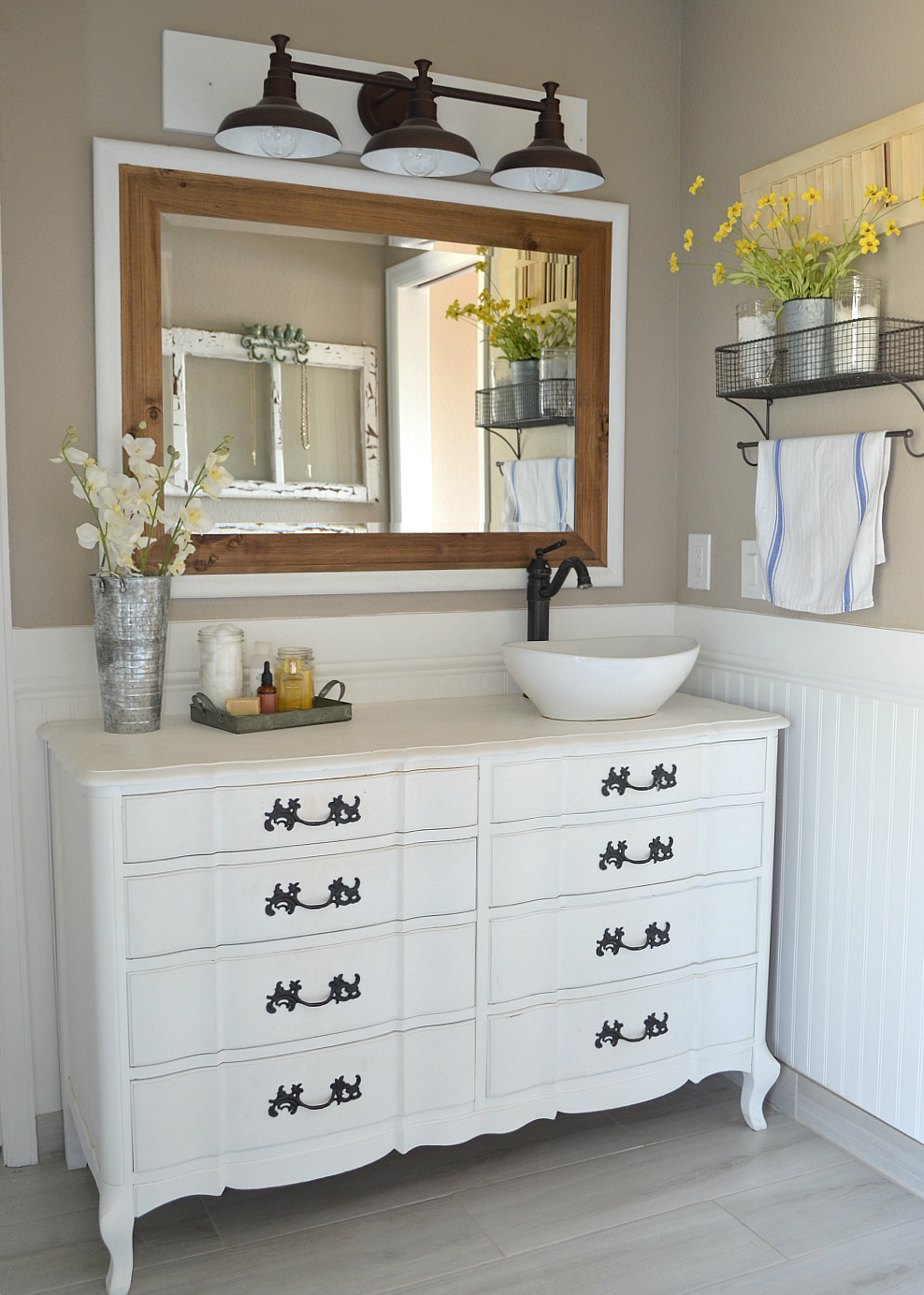 A modern farmhouse bathroom. An honest review of chalk painted bathroom vanities.