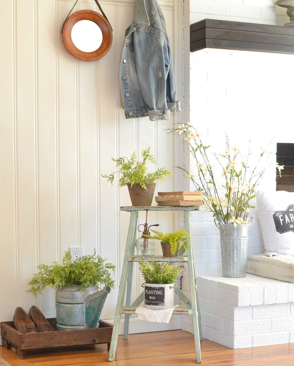A Simple Vintage Spring Entryway. See how this farmhouse entryway is styled with a vintage ladder and touches of spring decor!