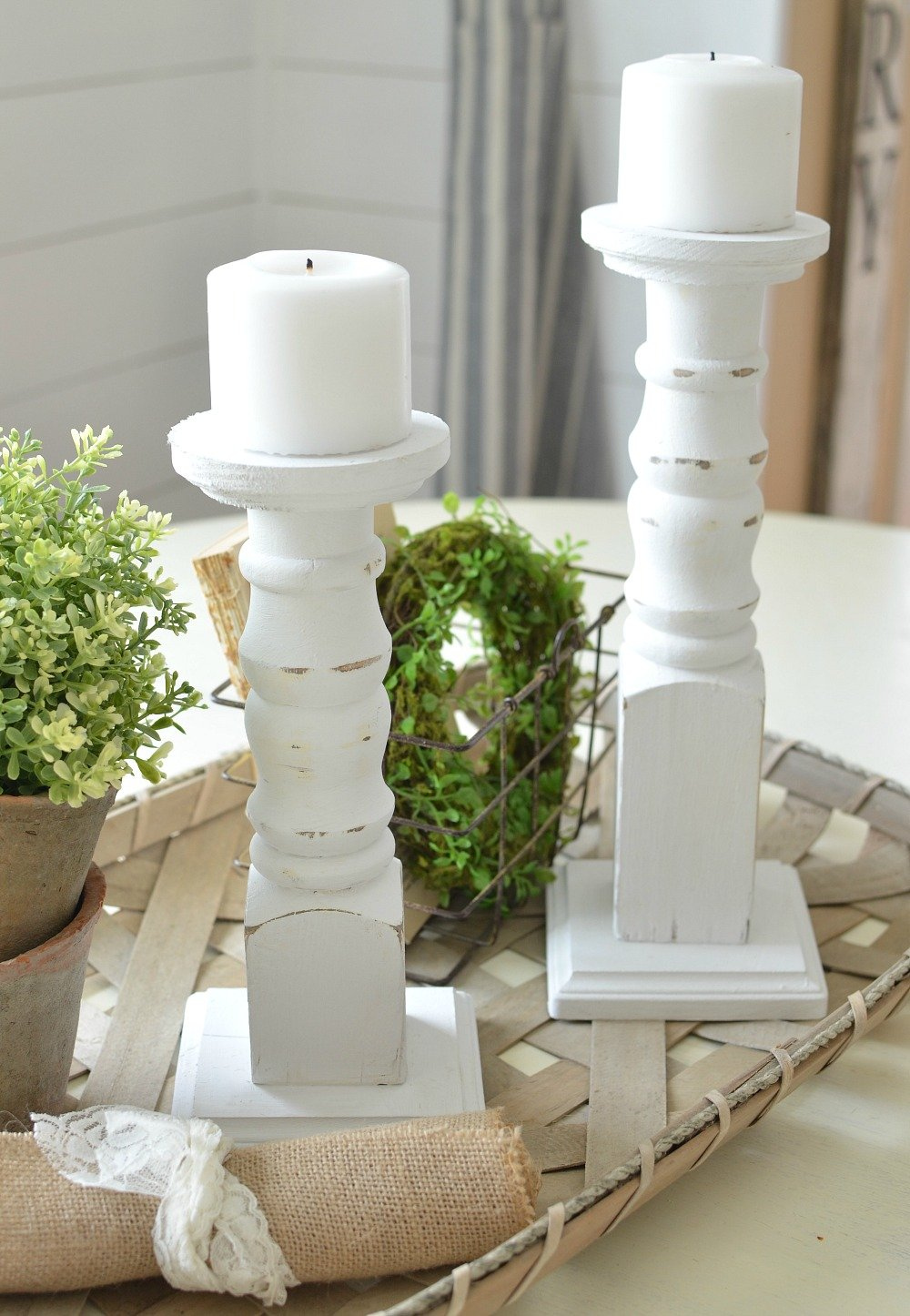 The Easiest DIY Farmhouse Candlesticks. Check out this easy tutorial to see how old spindles were used to make farmhouse style candlesticks in just a few simple steps!