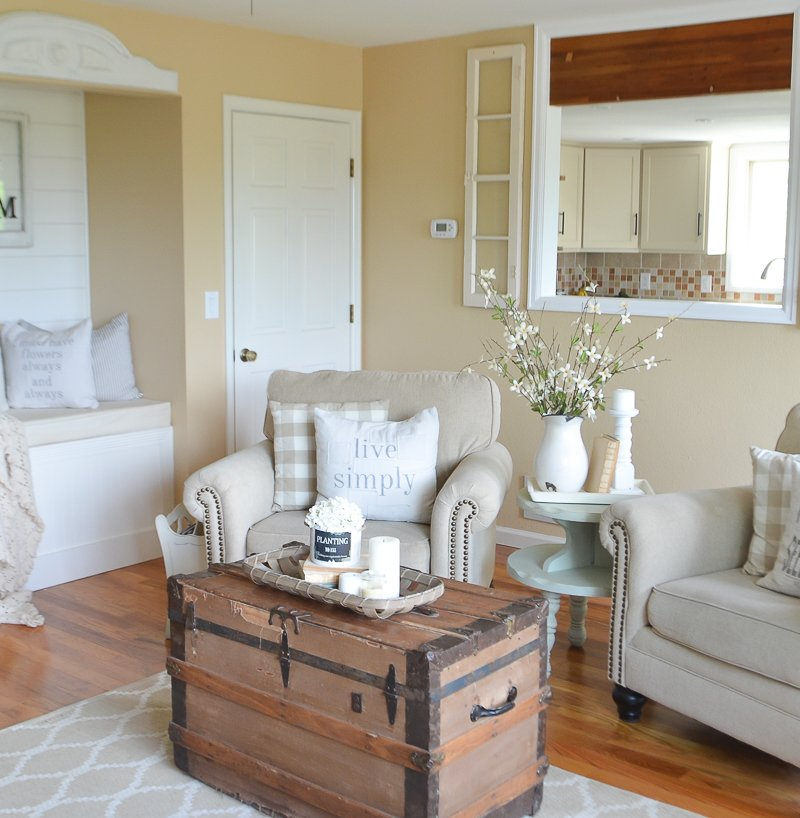 Farmhouse style living room with passthrough into kitchen
