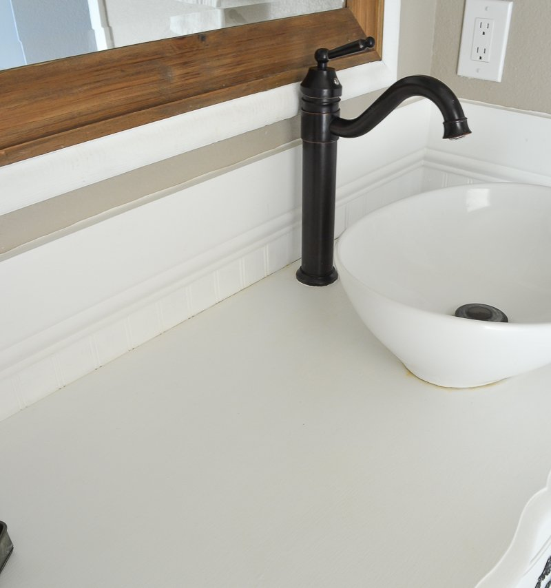 New and Improved Farmhouse Bathroom Vanities. How to cover bathroom vanities with a clear polycrylic topcoat.