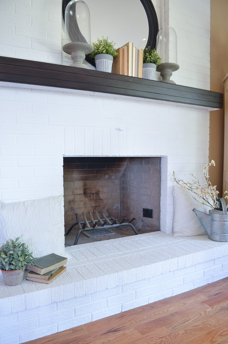 DIY Fireplace Curtain. Creative and simple way to cover a fireplace opening.