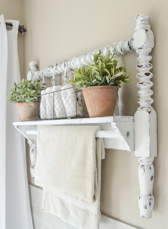DIY towel bar from Jenny Lind bed frame. Great farmhouse style bathroom decor idea!