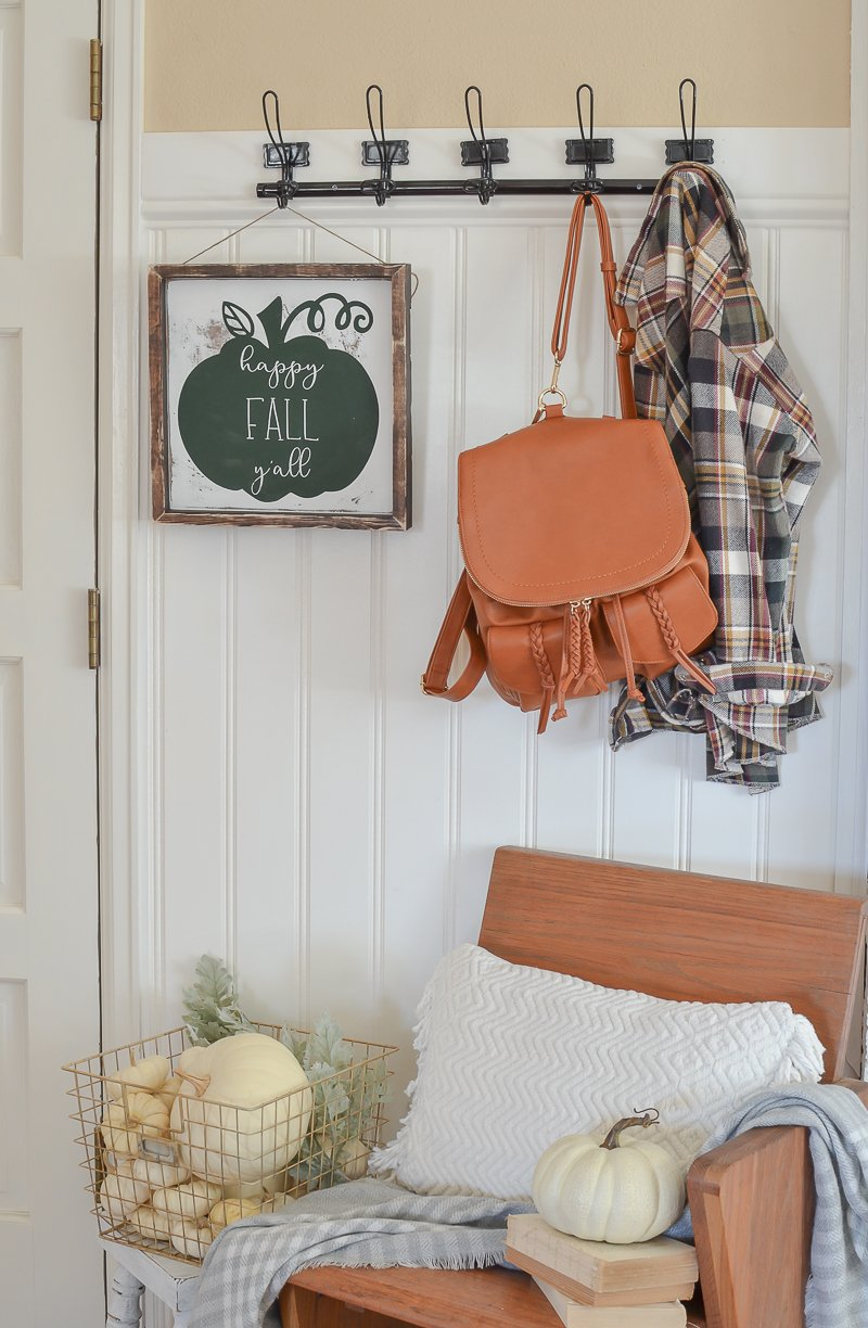 Farmhouse style fall entryway decor.