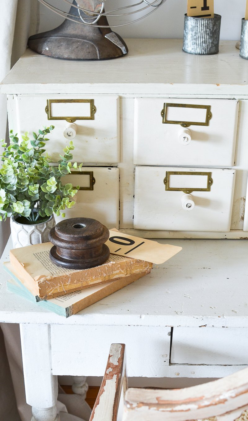 farmhouse style decor idea with old books and wooden pulley