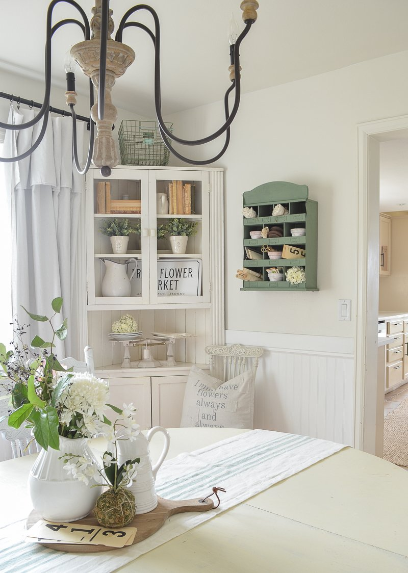 Farmhouse style dining room decor with vintage metal cubby