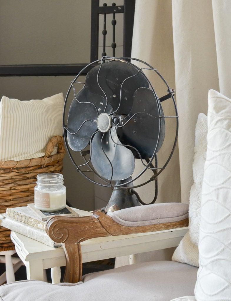 Farmhouse style decor with black vintage fan.