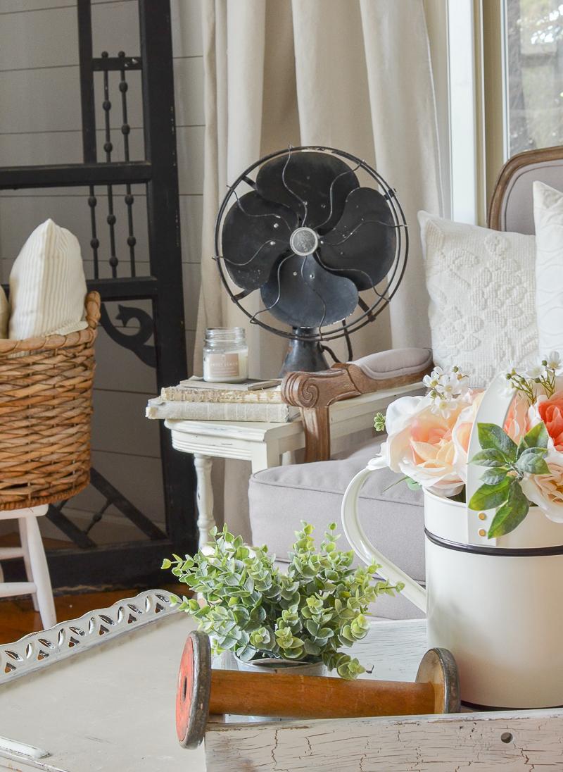 Vintage farmhouse decor with black antique fan