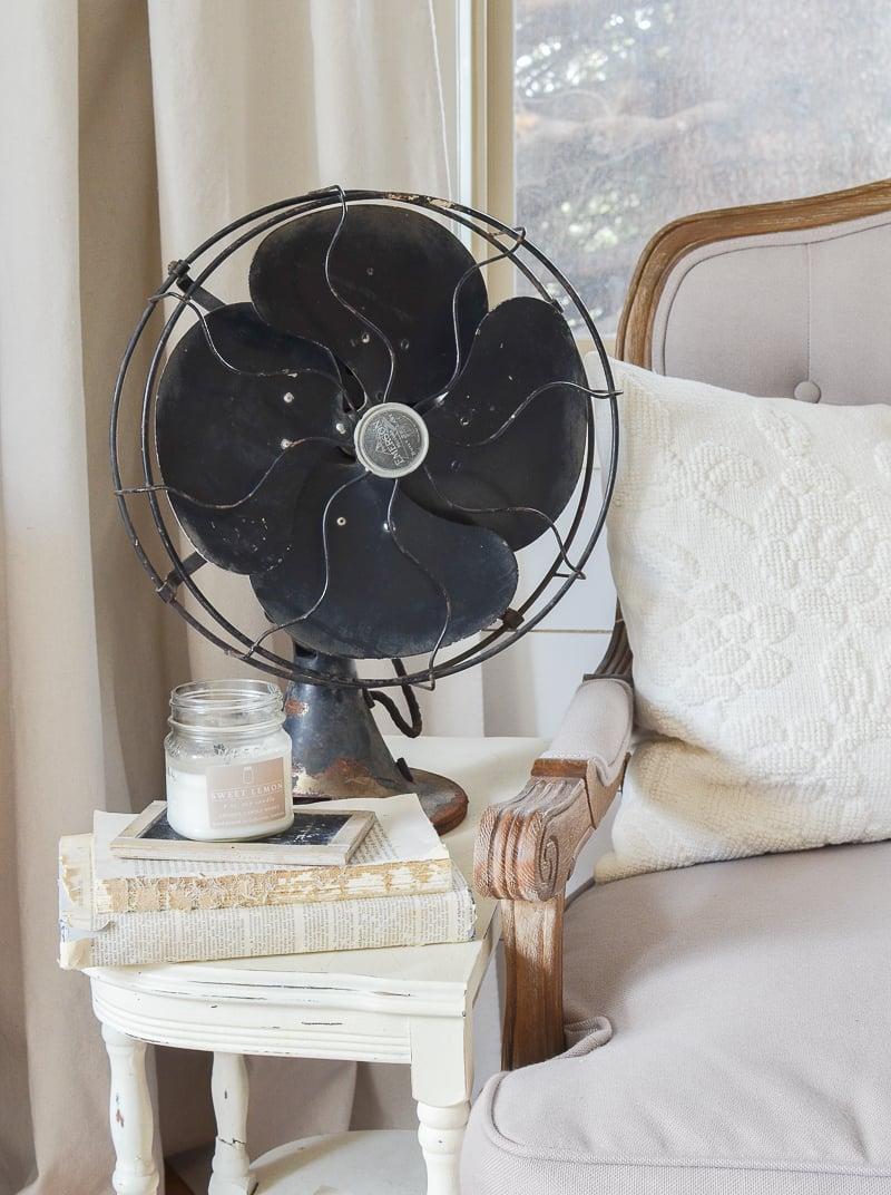 Vintage farmhouse decor with a black antique fan