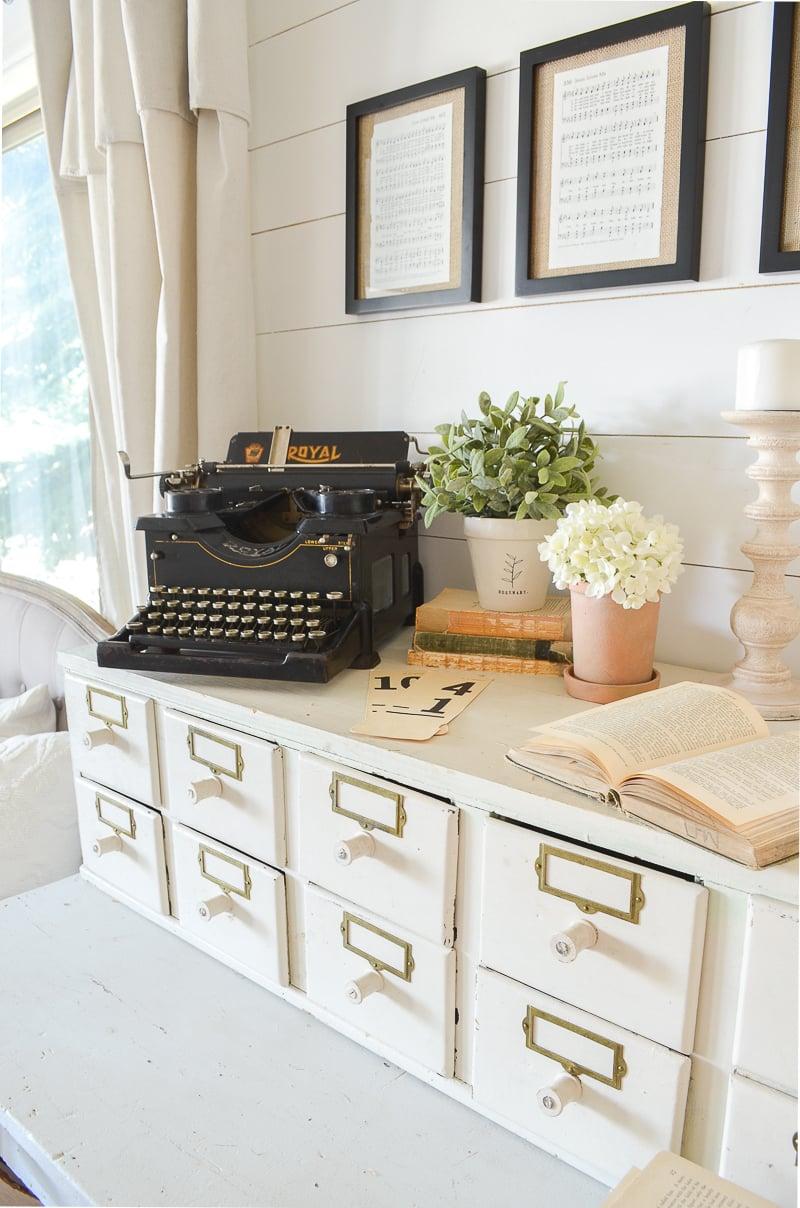 Farmhouse style decor with antique typewriter.