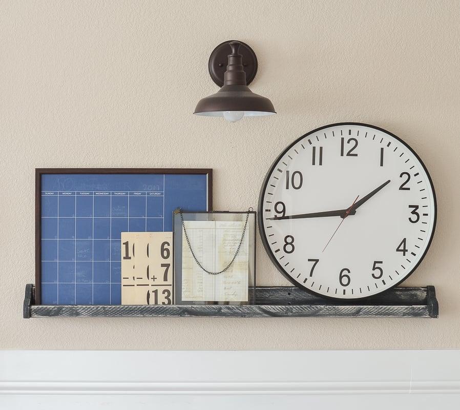 Farmhouse style shelf with layered decor and oversized clock!