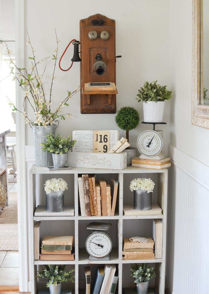 Farmhouse style decor and a vintage sewing machine drawer with old books