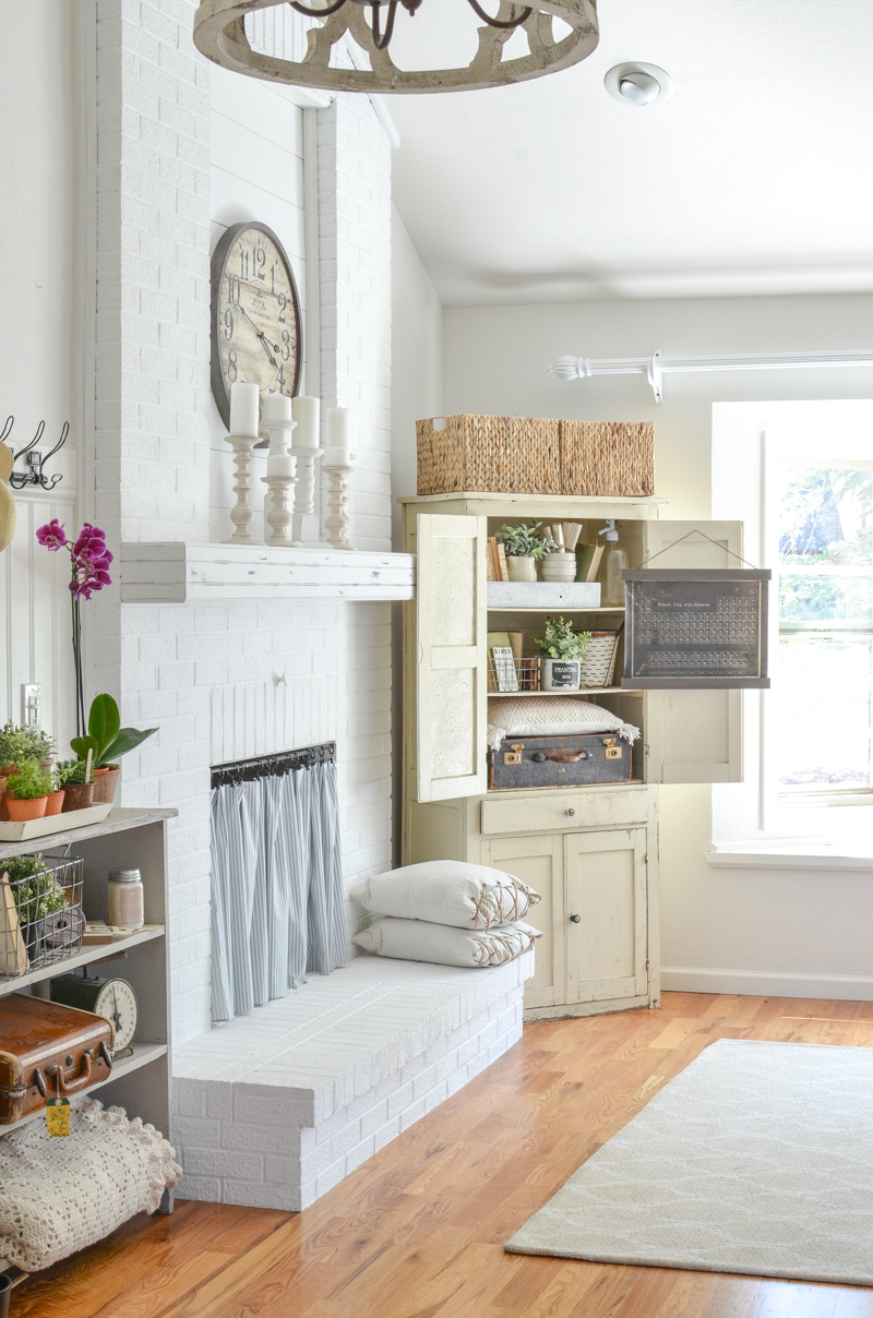 Farmhouse style decor in an antique cabinet