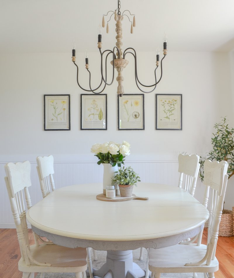 Simple farmhouse style dining room with botanical prints.