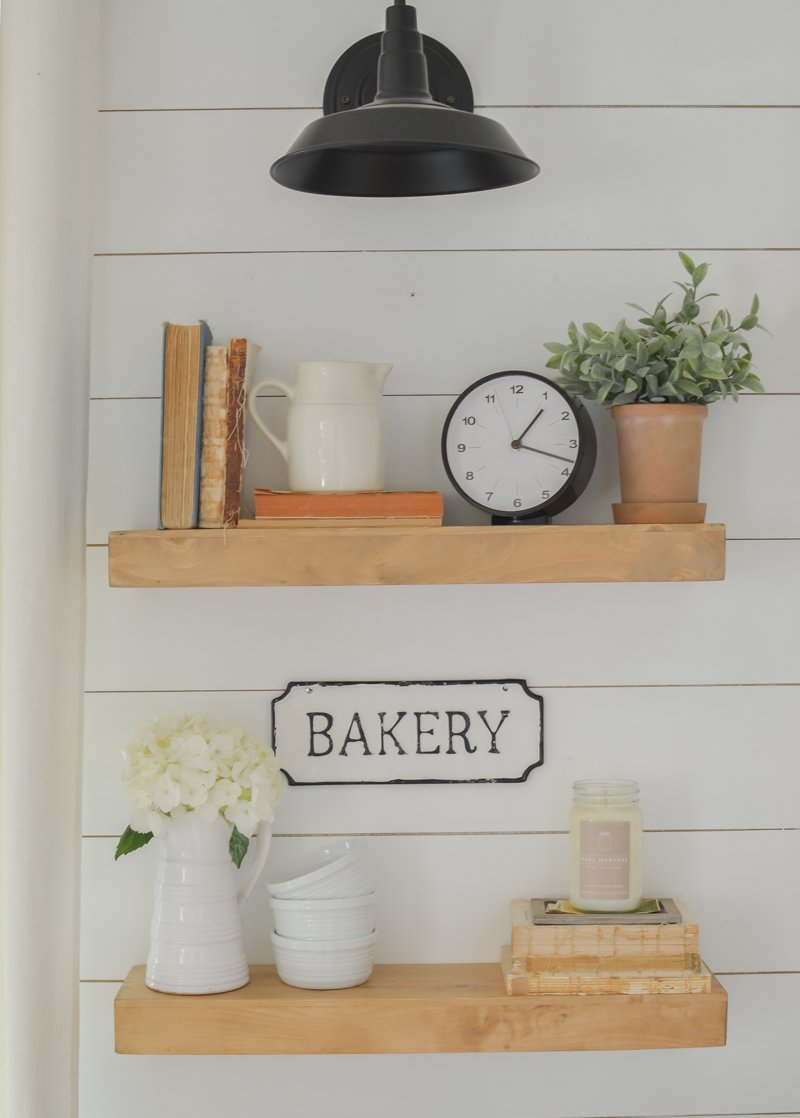 Farmhouse style floating shelves in the kitchen. The perfect floating shelves for any space in your home! Easy floating shelves are great for extra storage or to display decor pieces.