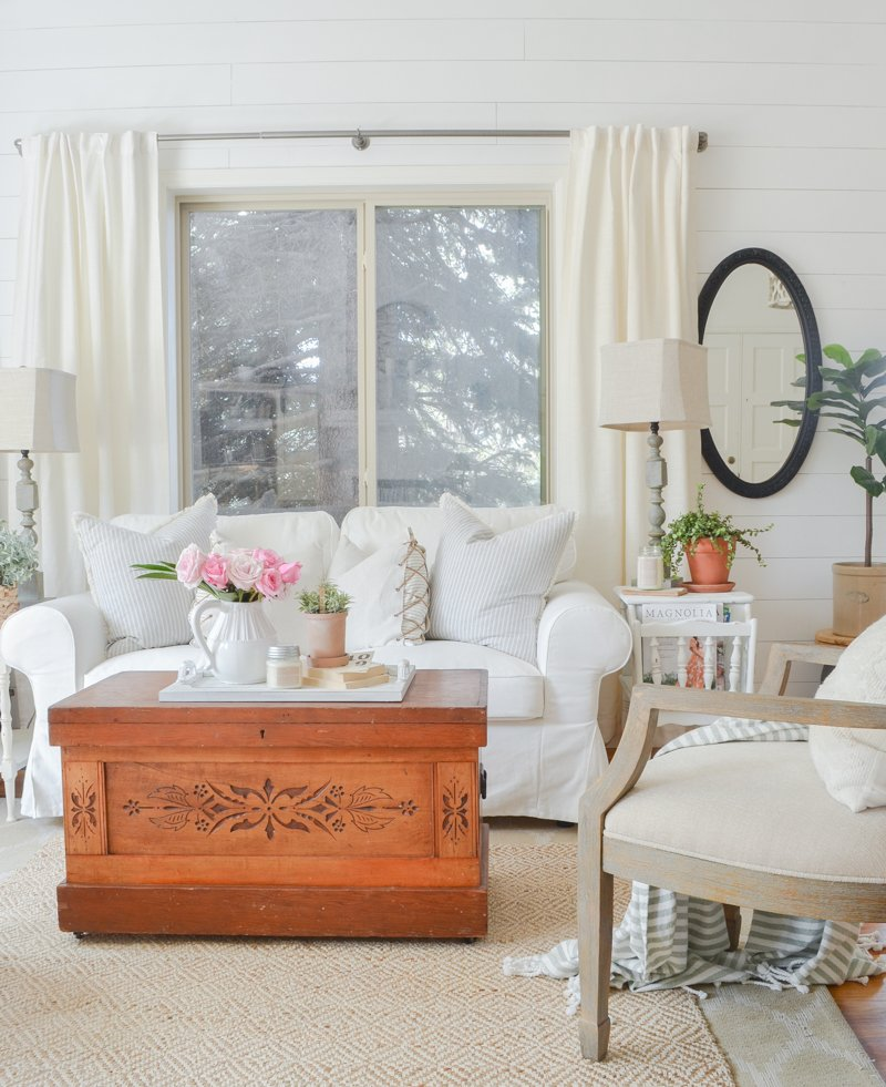 Farmhouse style living room decor. Vintage trunk used as coffee table.