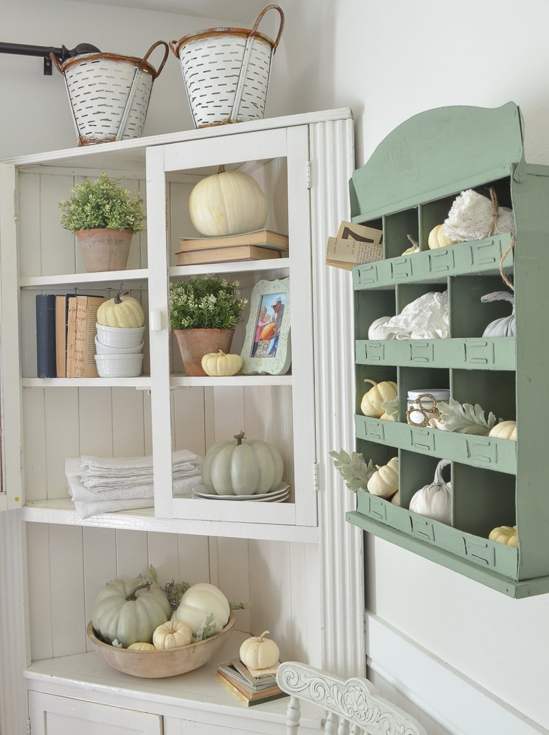 A Simple Fall Corner Cabinet. Farmhouse style fall decorating ideas for your home. Easy and simple fall decor! #falldecor #falldecorating #pumpkins