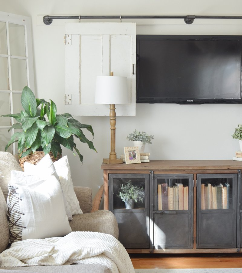 Farmhouse style living room. Great ideas for how to decorate around the TV.