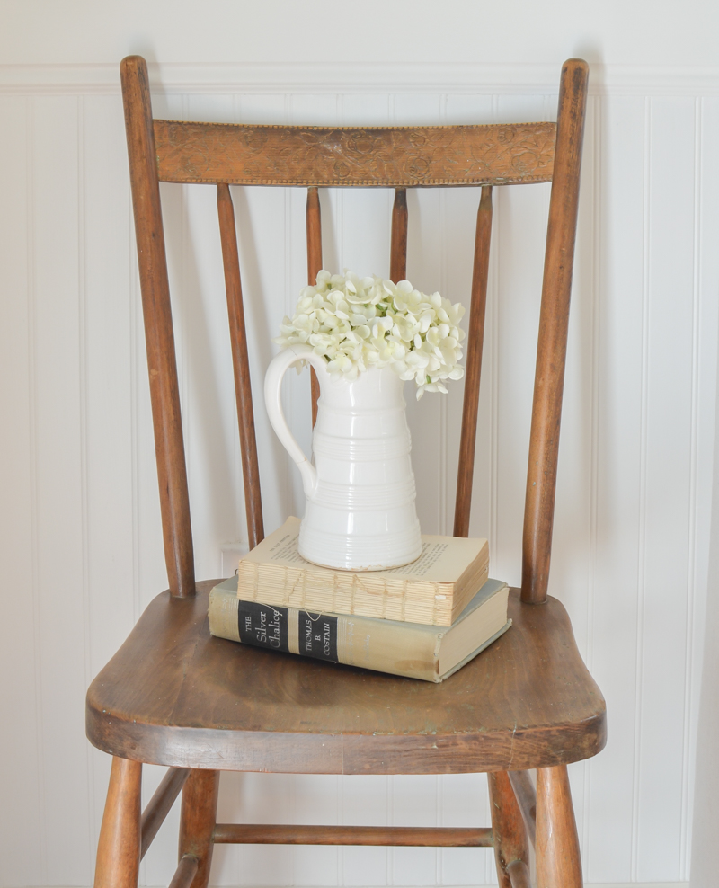 A simple wooden chair and old books. #vintagedecor
