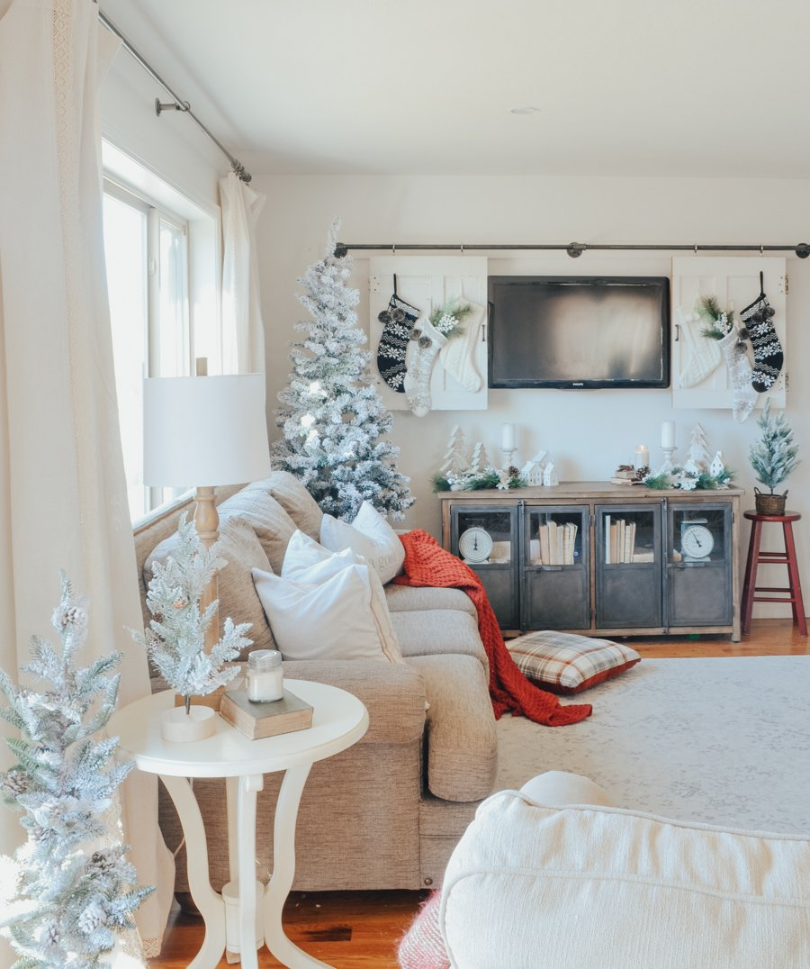 Cozy farmhouse style Christmas decor in the living room.