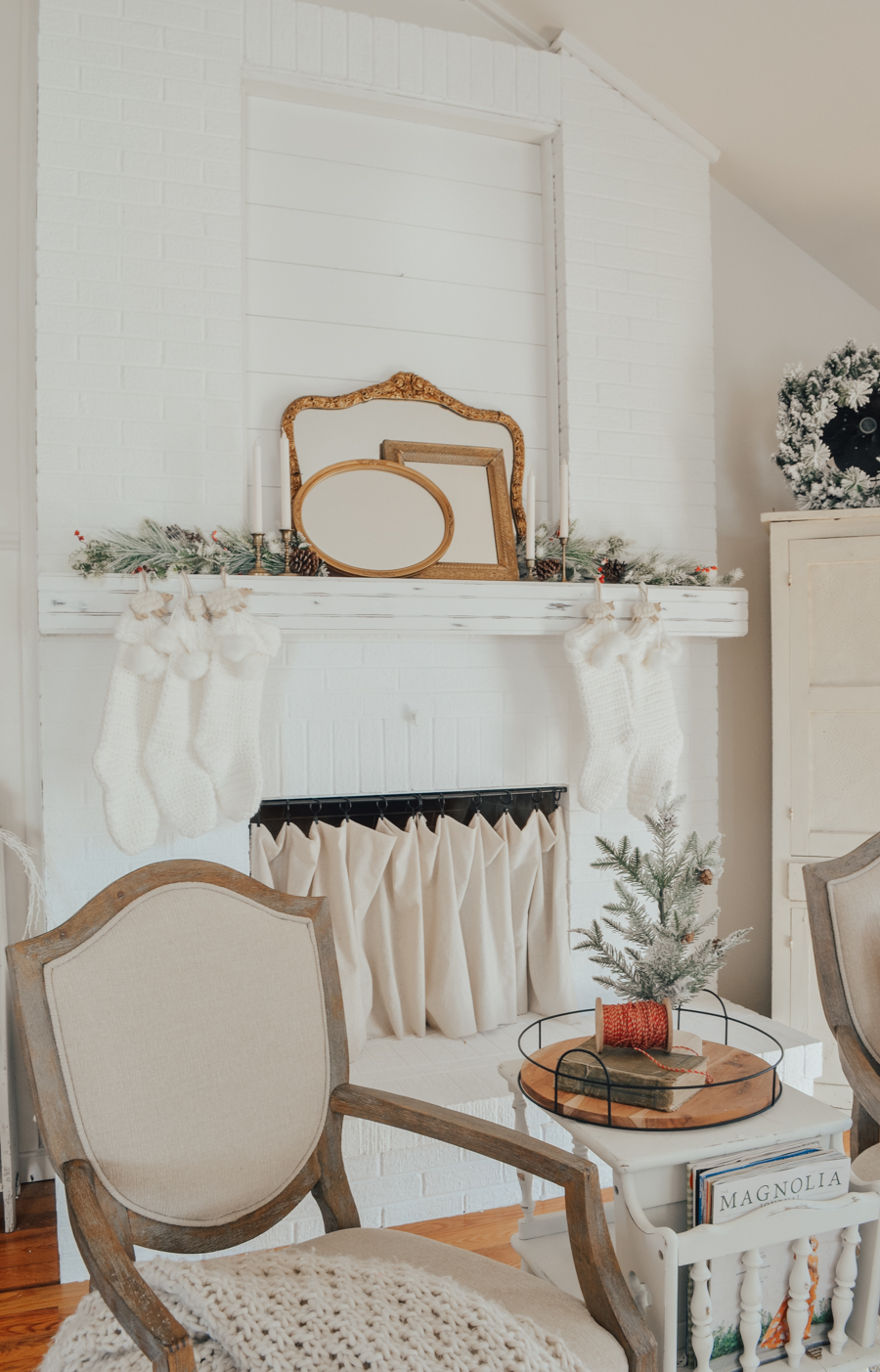 Simple Vintage Christmas Mantel. A simple mantel decorated for Christmas with antique mirror and candlesticks.