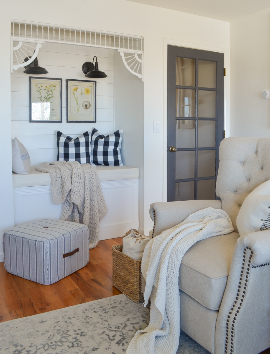 Farmhouse decor in the living room with cozy reading nook.