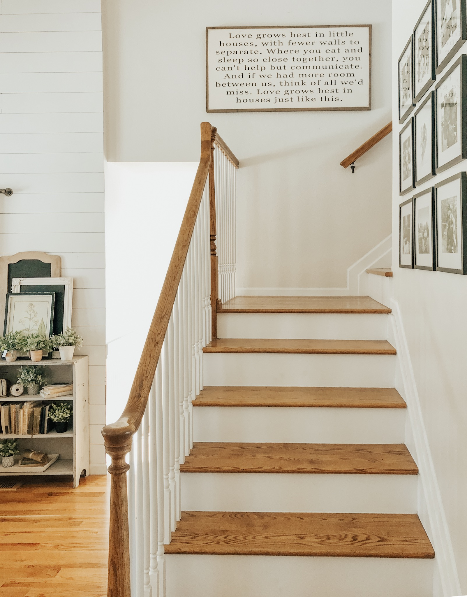 Love grows best in little homes sign. Farmhouse style decor and staircase.