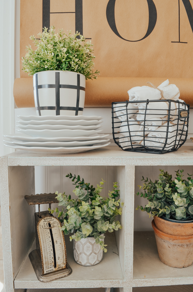 farmhouse style decor with vintage scale and faux greenery
