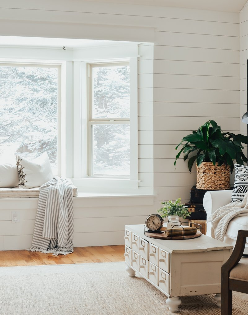 Farmhouse style window seat makeover. Beautiful farmhouse style window trim and shiplap wall.