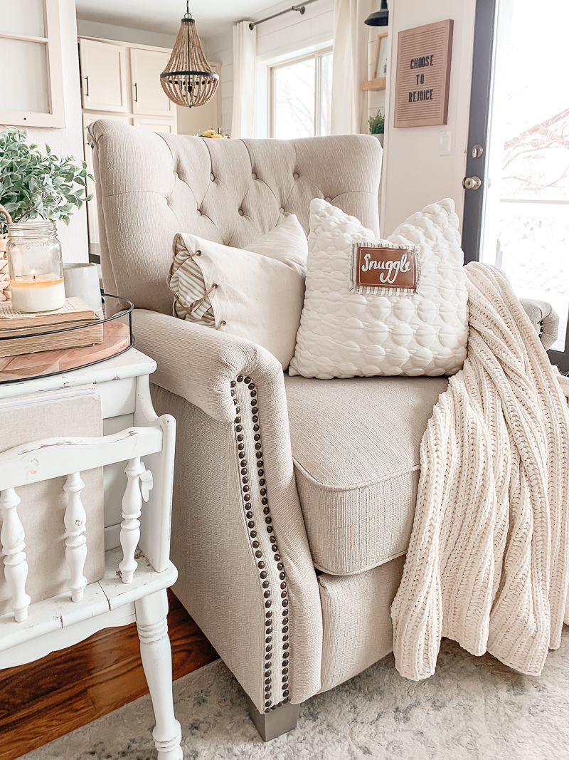Farmhouse style decor with cozy pillows.